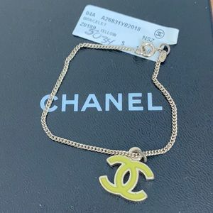 Auth. RARE CHANEL Gold tone Yellow Logo Bracelet